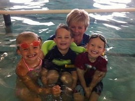 kids swimming with mother